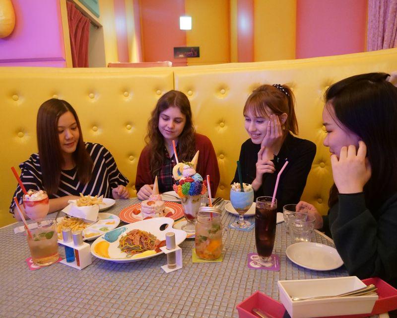People enjoy eating colorful kawaii food in Harajuku