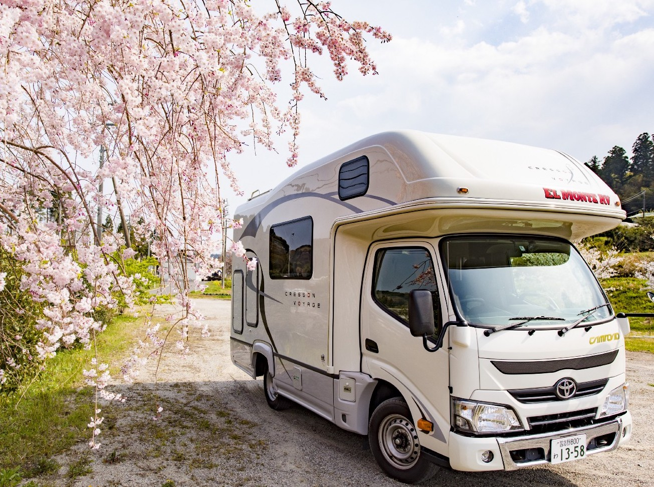RV with cherry blossoms