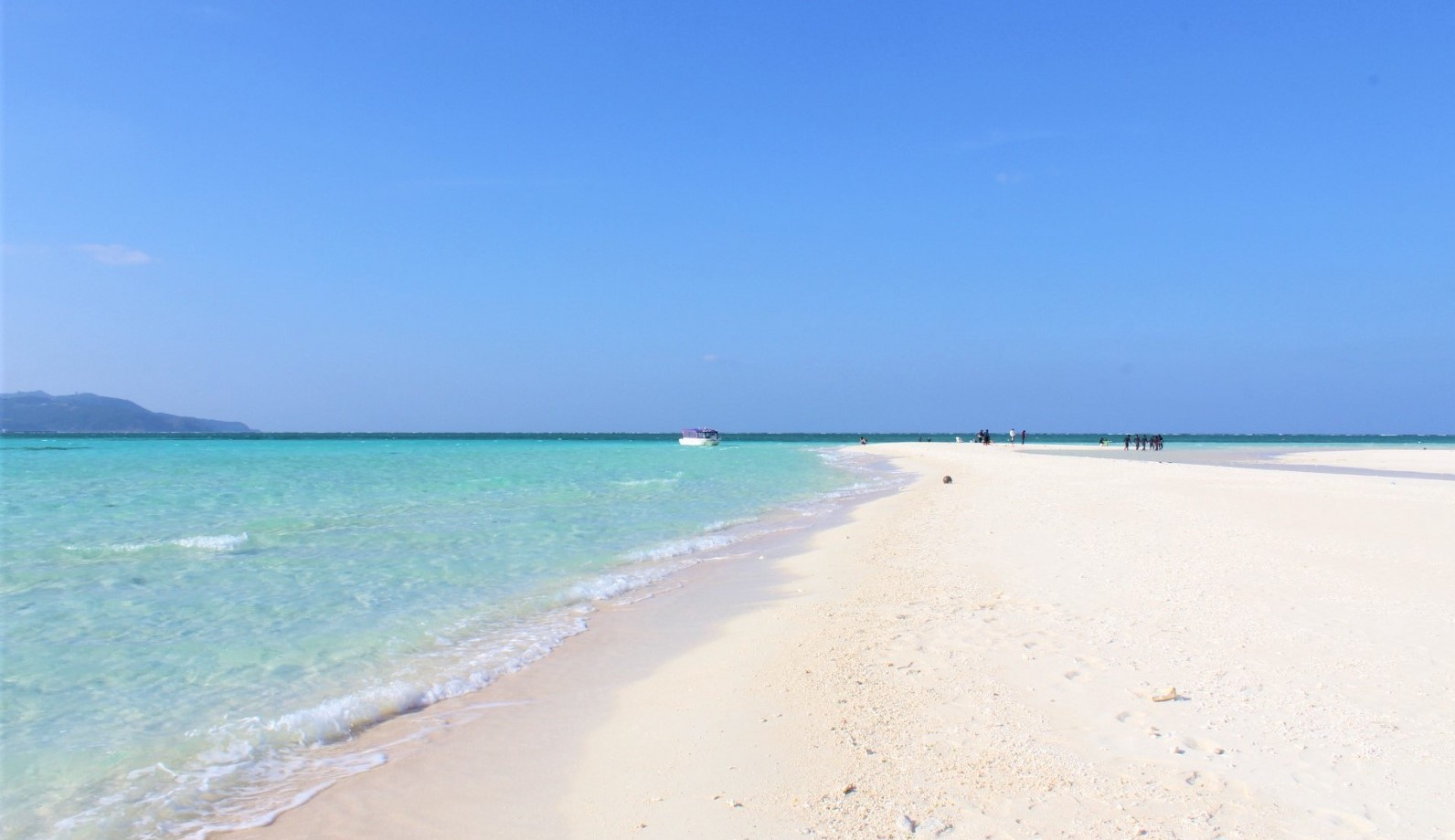 The beach on Kume island with pure white sand with clear blue water
