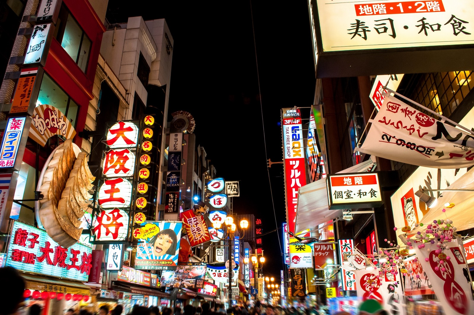 The bustling street of Dotonbori with flashy neon lights