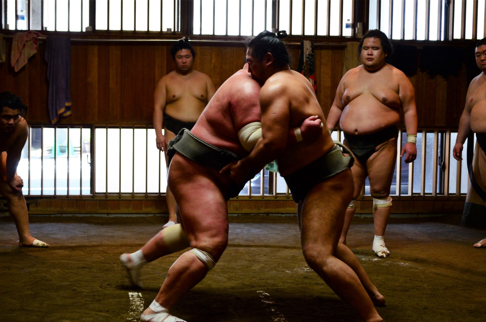 Sumo wrestlers practicing at the Sumo stable