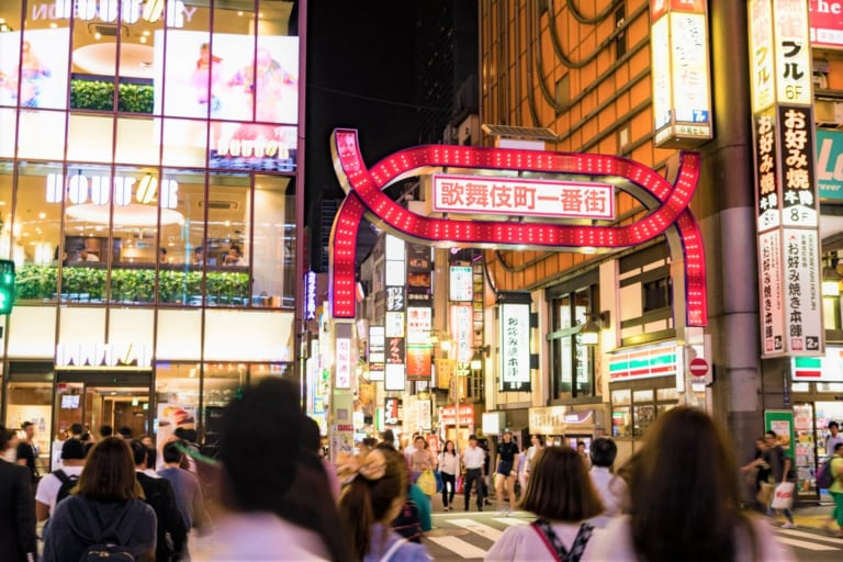 The bustling street with neon lights in Shinjuku