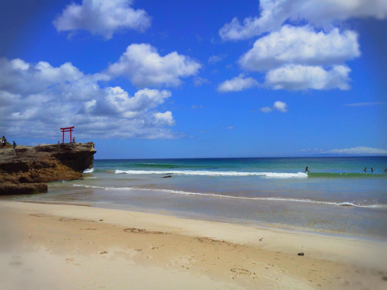 The beautiful Shirahama Beach with the red torii gate and the blue sky