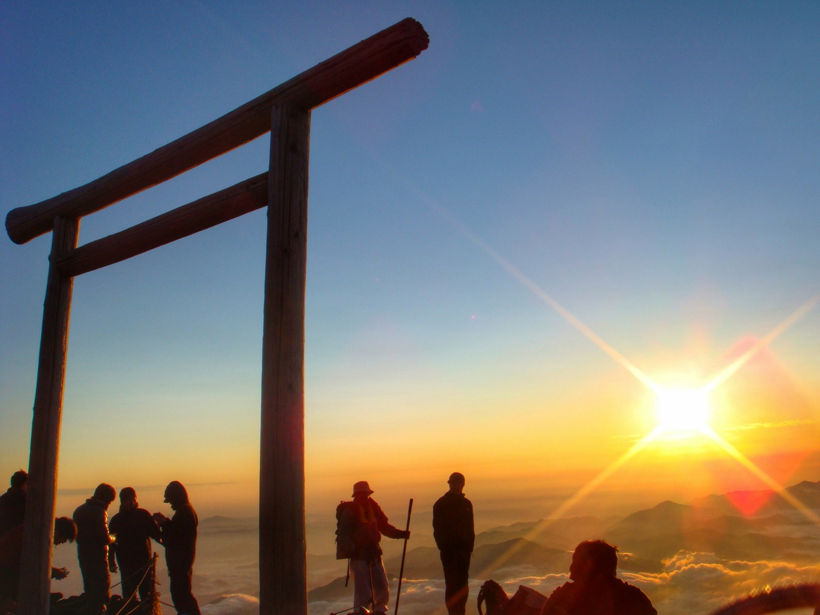 Watching the sunrise at the summit of Mt Fuji