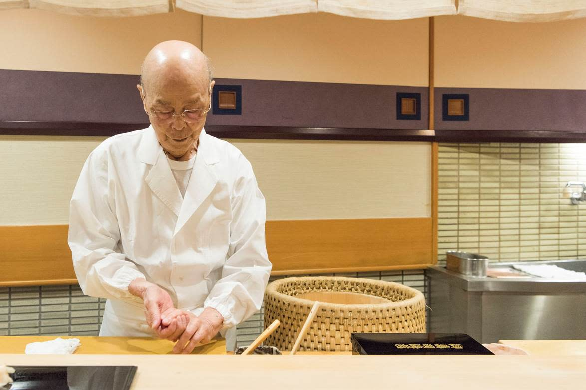 The legendary Sushi master Jiro Ono is making a piece of sushi