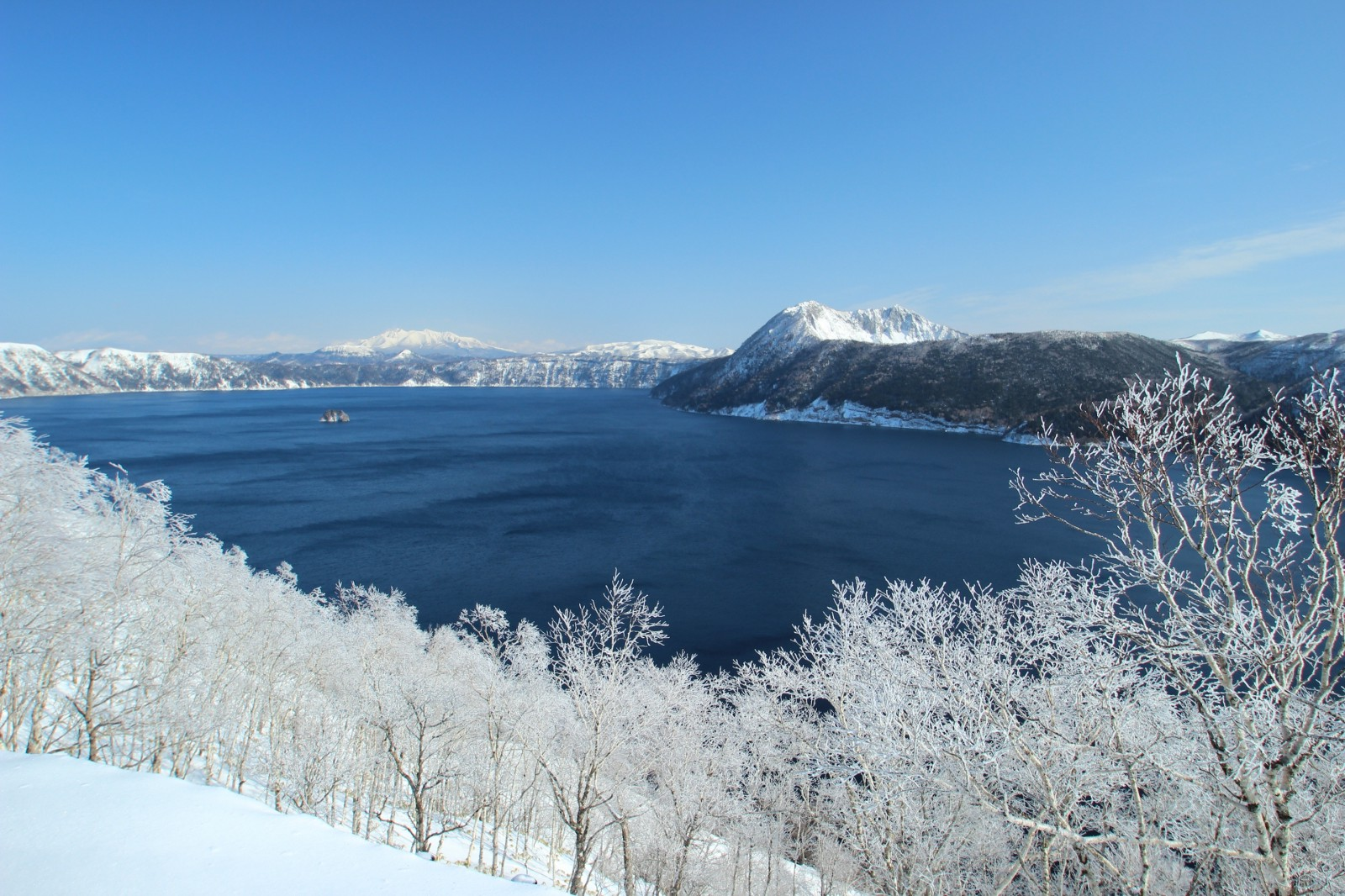 Lake Mashu covered with white snow during winter