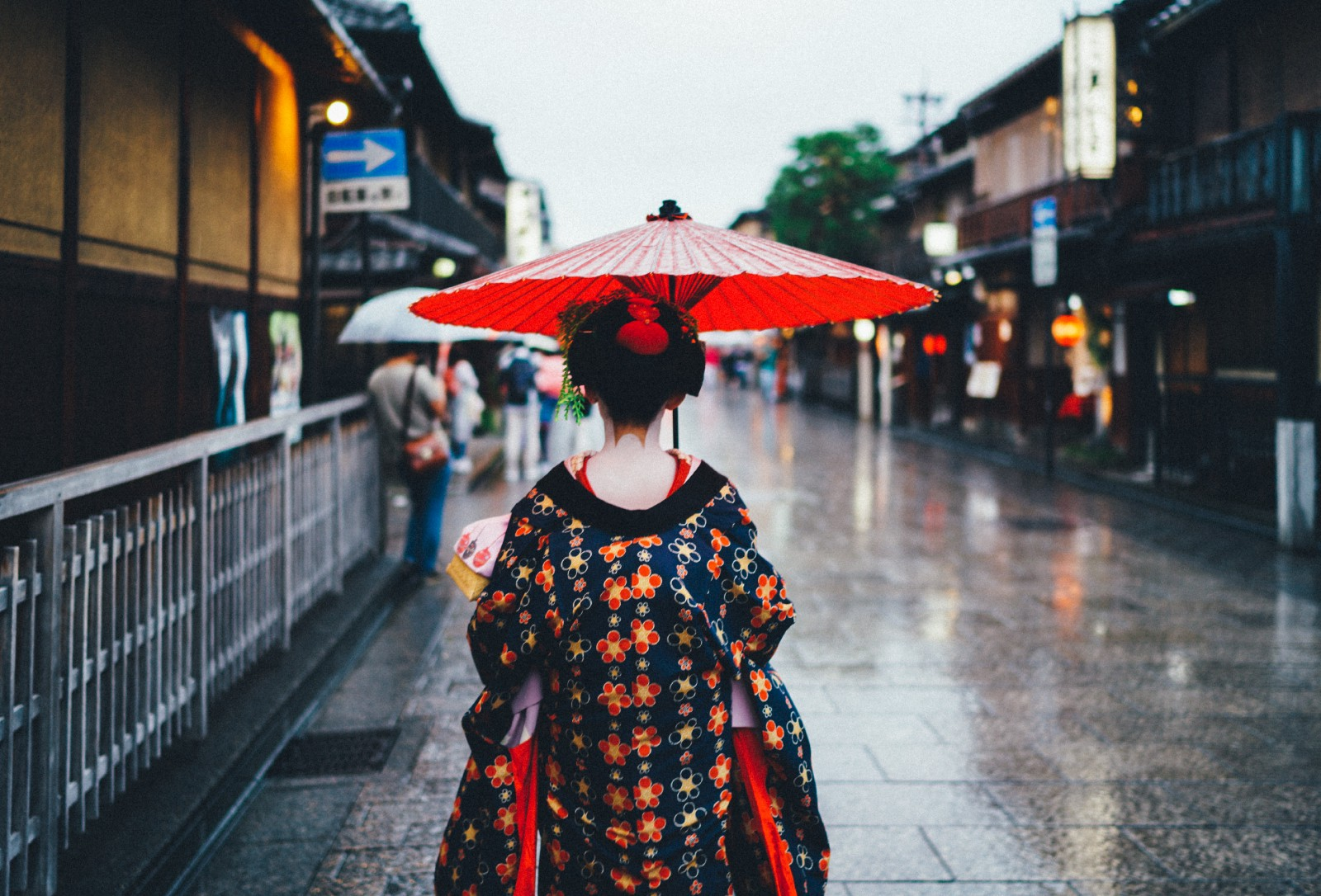 A Maiko girl walking down on the street of Gion