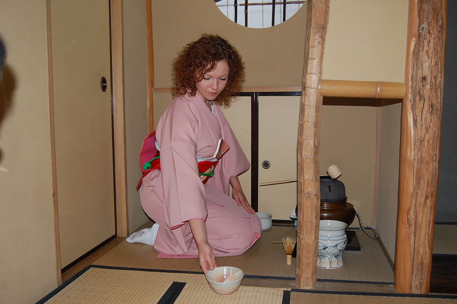 A woman enjoys the tea ceremony