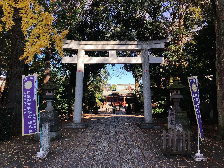A large white shrine gate (torii) of Musashino Hachimangu Shrine