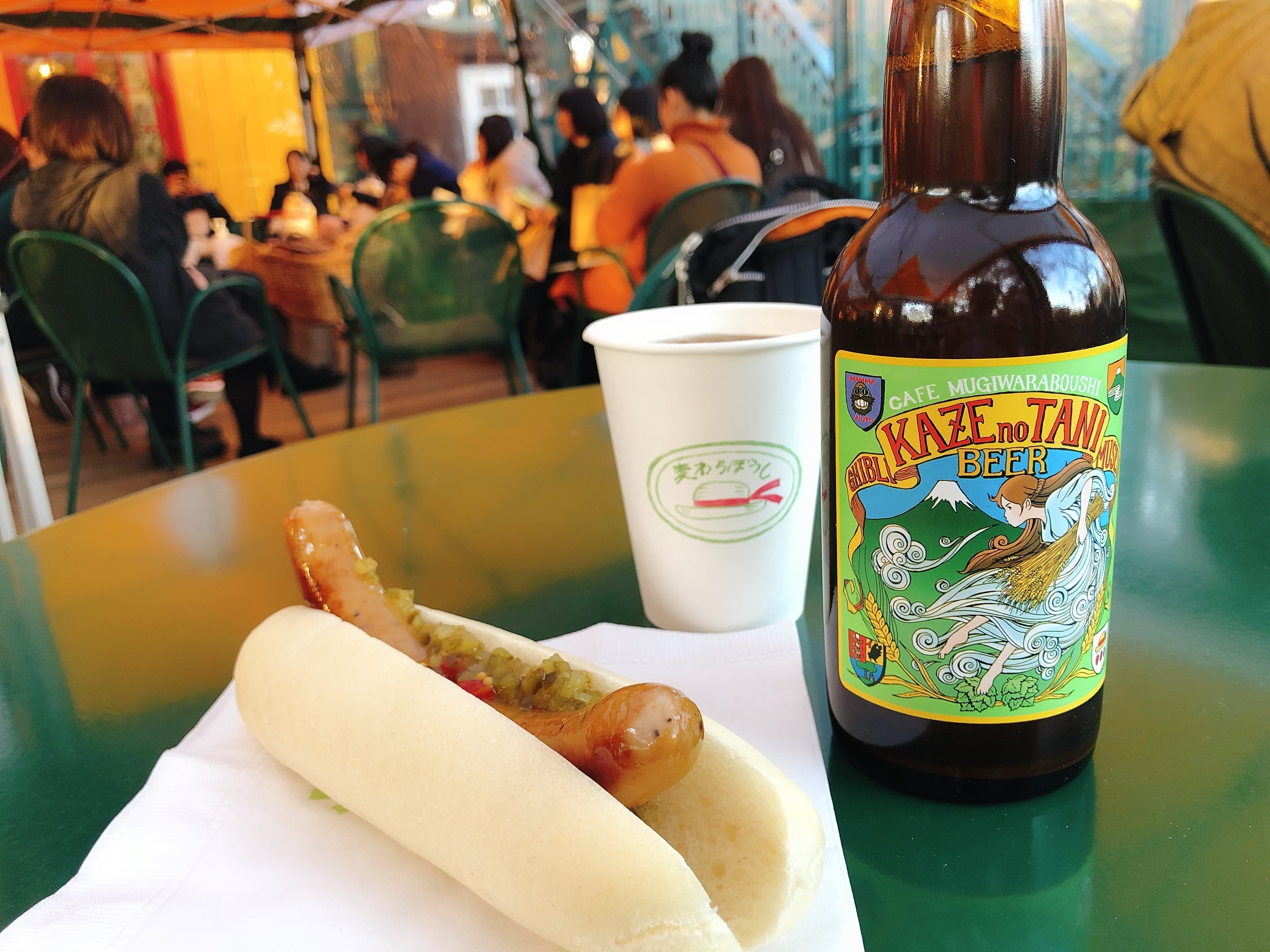 A hotdog and a bottle of beer at Café Deck Area