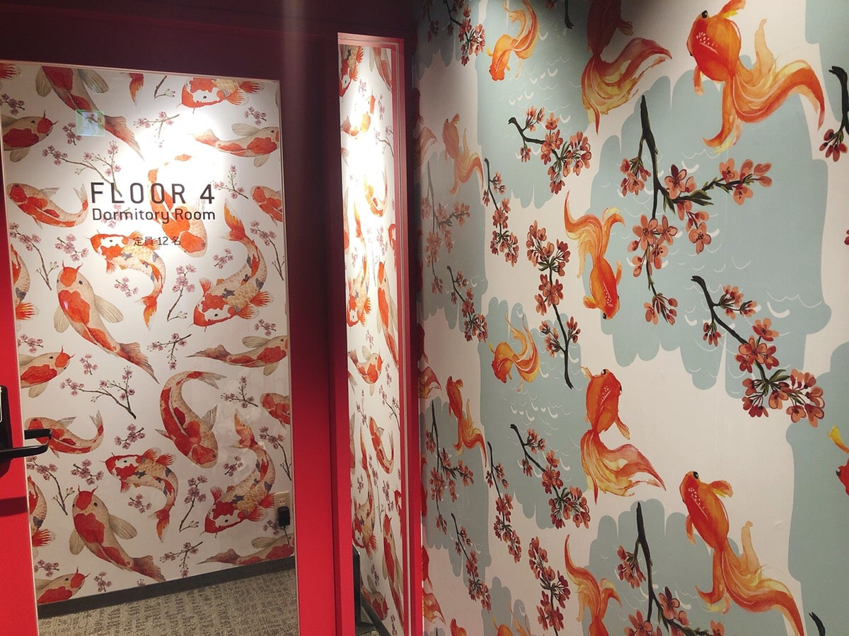 goldfish and carp painted on the wall.