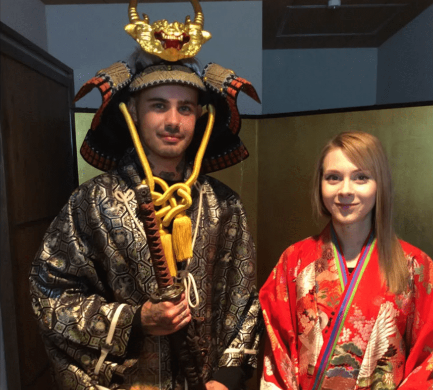 People disguising as Samurai with armors