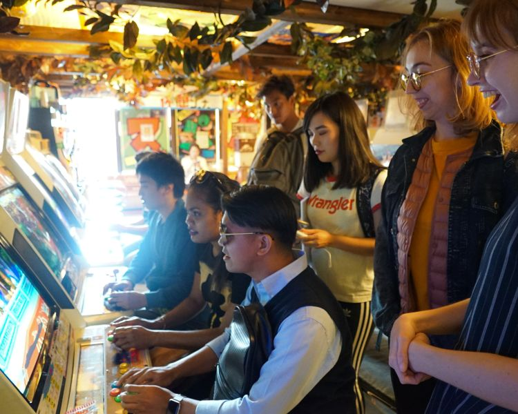 Enjoying games at the amusement arcade in Akihabara