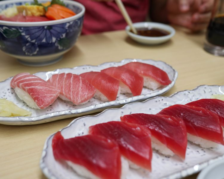 Several pieces of tuna sushi