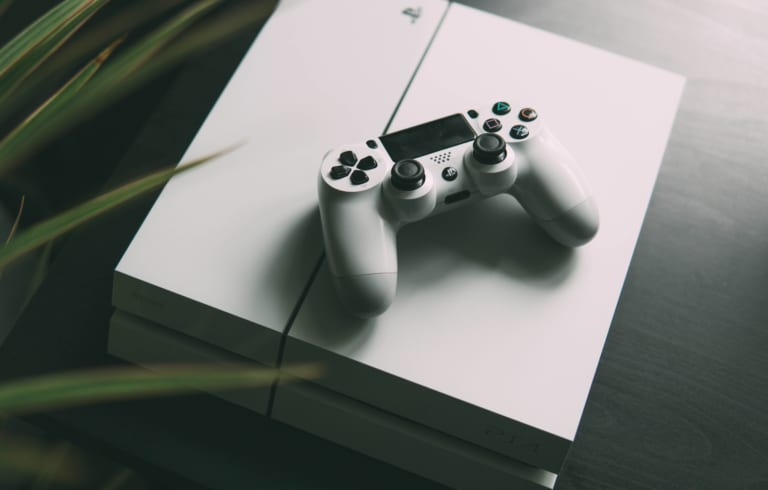 PlayStation 4 and a game controller